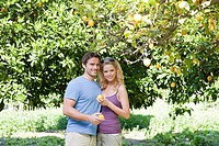 Couple by lemon tree