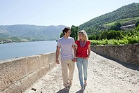 Couple walking by douro river