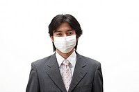 Businessman wearing a surgical mask
