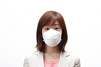 Businesswoman wearing a surgical mask