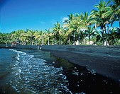 Black sand on the shore. Hawaii Islands, USA