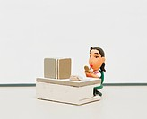 Figurine of a receptionist applying lipstick