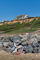 buildings on the cliff edge at Barton on Sea in Hampshire in danger of falling into the sea due to costal erosion