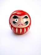 Daruma doll on white background