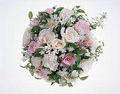 A round bouquet of pink and white roses