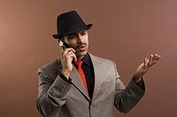 Actor portraying a businessman talking on a mobile phone