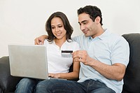 Couple doing online shopping with a laptop