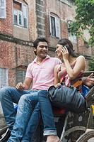 Couple sitting on a rickshaw, Kolkata, West Bengal, India