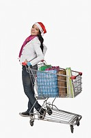 Woman standing near a shopping cart and smiling