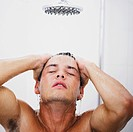 Close_up of a young man having a shower