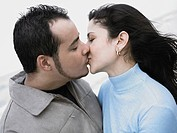 Close_up of a young couple kissing