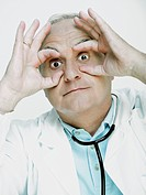 Male doctor pretending to wear glasses