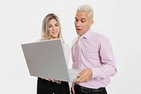 Businesswoman and a businessman using a laptop