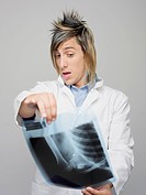 Close_up of a male doctor examining an X_Ray