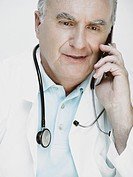 Close_up of a male doctor talking on a mobile phone