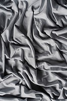 Close_up of folds of a silky fabric