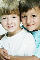 Portrait of a boy hugging his brother from behind
