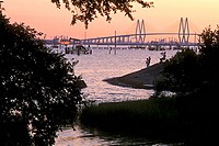 People Fishing on Bank of Channel with Fred Hartman Bridge in Background