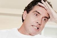 Close_up of a mature man with a headache