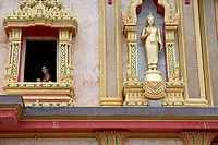 family golden palace in phuket thailand statue
