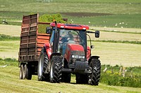 Kirbister STROMNESS AREA ORKNEY Silage tractor and grass trailer