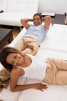 people couple home african american enjoying 30s