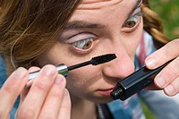 woman beauty face young applying makeup model