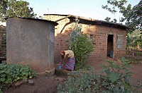woman water home women uganda in najjemba taking