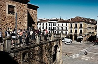 group of tourists in the old town. Caceres, Spain