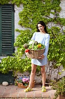 girl with a basket of vegetables