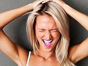 Beautiful blond woman screaming