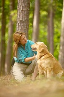 woman looking lovingly at Golden Retriever