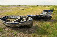 Broken Fishing Boat lying in a Coastal Marsh Landscape near the Village of Kessingland in East Anglia, England