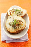 Baked pear stuffed with blue cheese and walnuts