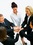 Teamwork and team spirit _ Multinational group of casual business people with their hands together