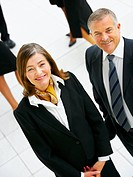 Portrait of a senior business couple, in an office environment Taken from above