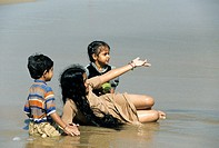 Childern playing on the beach,Marina Beach,Chennai,Madras,Tamil Nadu