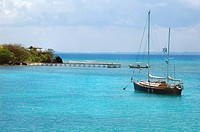 Sailboat anchored in gorgeous blue caribbean water