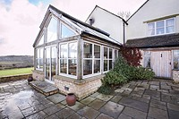 An oak framed Orangery type conservatory attached to a house in the country