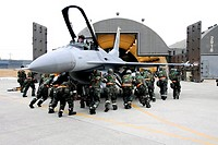 Airmen from the 79th Fighter Squadron push an F-16 Fighting Falcon into a hangar Jan  15 at Kunsan Air Base, South Korea  More than 300 Airmen and sev...