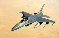 An F-16 Fighting Falcon aircraft returns to the fight after receiving fuel from a KC-135 Stratotanker during a mission over Iraq  The F-16 is a compac...