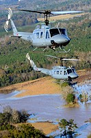 Students from the 23rd Flying Training Squadron at Fort Rucker, Ala , piloting UH-1H Iroquois helicopters, practice formation-flight patterns  The 23r...