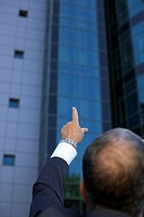 Person pointing at an office building