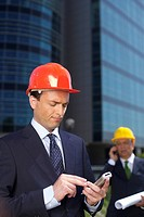 Businessman with hardhat using a mobile phone