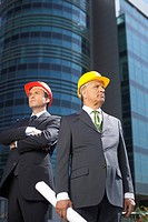 Two businessman wearing hardhats (thumbnail)