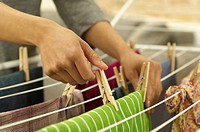 Woman hanging washing on clothes horse