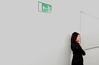 Pensive businesswoman on office corridor, Munich, Bavaria, Germany (thumbnail)