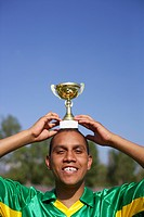 Brazilian kicker with cup on head