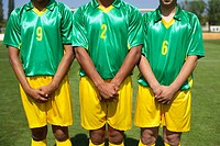 Brazilian kickers standing side by side