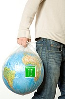 Man carrying garbage bag with globe, Germany